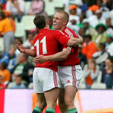 Keith Earls is congratulated by Shane Williams after scoring his try