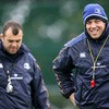 A smiling Jonno Gibbes (forwards coach) is pictured alongside Michael Cheika during the session at Belfield