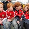 Gerard, John and Fionn O'Tiarnaighfrom Limerick look at their sister Aine as they wait to meet the Munster players