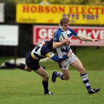 Dungannon winger Chris Cochrane is tackled by Dolphin's Rory Keneally