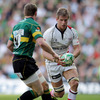 Ulster flanker Chris Henry runs towards Northampton's Chris Ashton during Sunday's absorbing encounter in Milton Keynes