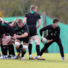 As the Ireland forwards work on their scrummaging technique, Conor Murray looks to fire a pass away from the base