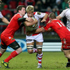 Ulster replacement Chris Henry looks to barge his way past Munster's Denis Hurley and Paul Warwick