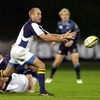 Leinster scrum half Chris Whitaker floats a pass out during the televised tie