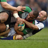 Leinster's Australian scrum half Chris Whitaker tackles Harlequins centre Jordan Turner-Hall to ground