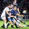 Leinster scrum half Chris Whitaker gets his pass away despite pressure from the Ospreys defence