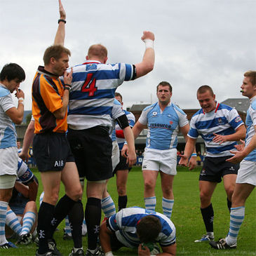Referee Simon McDowell signals for a Blackrock try