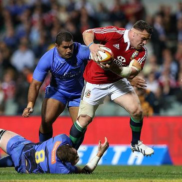 Cian Healy carries the ball forward for the Lions