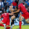 Ball carrier Cian Healy keeps his legs pumping as he is challenged by Edinburgh's Ross Ford and Grant Gilchrist
