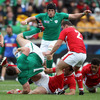 Cian Healy is upended by influential Welsh centre Jamie Roberts as the sides battle it out for a place in the last-four of the tournament