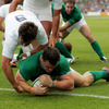 Cian Healy is pictured dotting down for his first international try, despite the best efforts of France scrum half Morgan Parra