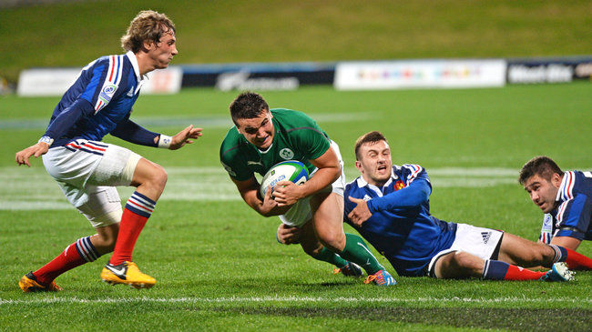 Cian Kelleher scoring against France at the Junior World Championship