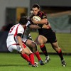 Edinburgh's Nick De Luca tries to break past Ulster scrum half Cillian Willis during Friday's clash at Ravenhill