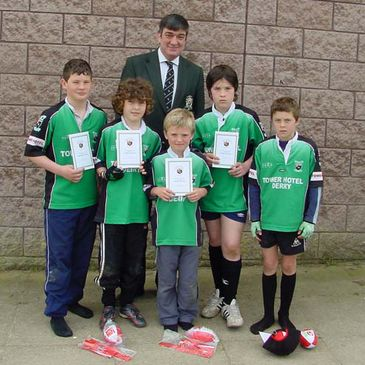 Andrew McCartney with some of Derry's Mini Rugby stars