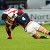 The Scarlets' Lou Reed goes low to stop Ulster full-back Clinton Schifcofske in his tracks