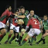 Connacht number 8 Colm Rigney powers ahead under pressure from Portugal's Eduardo Acosta and Joao Correia