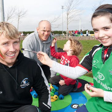 Fionn Carr and Johnny O'Connor have their faces painted by young Connacht fans