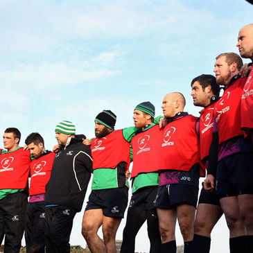 The Connacht players huddle together during training
