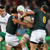 Ireland's all-action openside Conor Gilsenan ships a double tackle from South Africa's Jan Serfontein and Shaun Adendorff