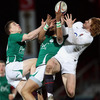 Ireland's Andrew Conway and Simon Zebo compete for a high ball with England Under-20 winger Will Hurrell