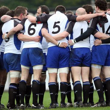 The Cork Constitution players huddle together before a game