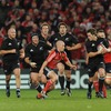Munster scrum half Peter Stringer, one of the best players on the night, lines up a tackle on New Zealand's Cory Jane