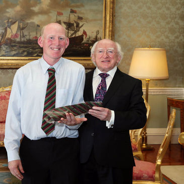Paul Hogan presents President HIggins with a DLSP tie