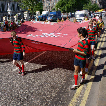 These rugby-playing kids helped parade the giant jersey through Belfast