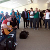 Earlier on, Damien Varley played some Christy Moore songs for his team-mates and members of the public at Rotorua Airport