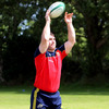 Damien Varley, one of Munster's latest recruits, practises his lineout throwing in the Cork sunshine