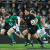 New Zealand out-half Dan Carter dashes through a midfield gap as Ireland come under some early pressure