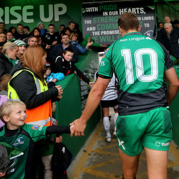 A young fan greets Dan Parks at the Sportsground