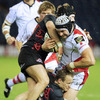 Ulster's Ireland-capped lock Dan Tuohy feels the force of a double hit from Edinburgh's Ross Rennie and James King