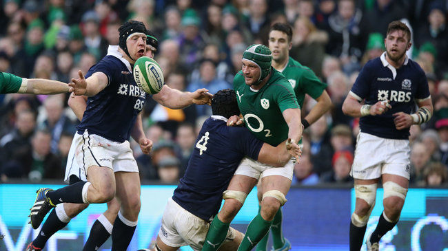 Dan Tuohy gets an offload away against Scotland