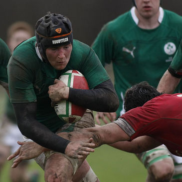 Ireland Schools number 8 Daniel Qualter tries to get past Wales' Cory Hill