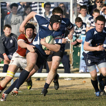 Sligo Grammar's Danny Qualter takes the ball on