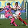 Making his Heineken Cup debut, Ulster centre Darren Cave tries to wrong-foot Stade's Brian Liebenberg