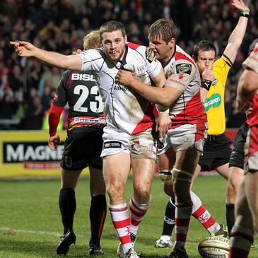 Darren Cave celebrates after scoring against the Dragons