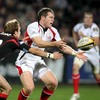 Ulster's Darren Cave gets his pass away under pressure from Edinburgh out-half David Blair