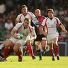 Ulster centre Darren Cave has scrum half Cillian Willis in support as his run is ended