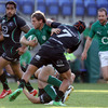 Darren Cave shows his strength as he holds off Connacht flanker Ray Ofisa, with Geordan Murphy offering support