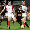 It is a race between Ulster centre Darren Cave and the Dragons' Rory Sidey for a loose ball