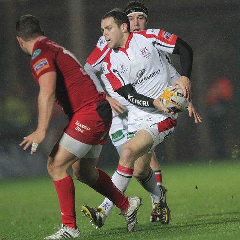 Ulster's Darren Cave takes on the Scarlets defence