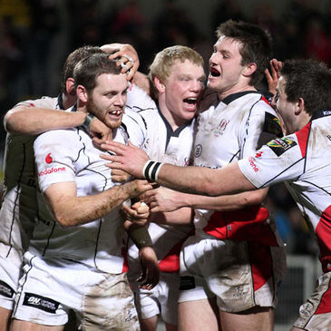 Darren Cave is mobbed by his team-mates after scoring against the Dragons