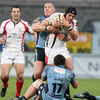 Ulster flanker David Pollock is caught in possession by Cardiff's John Yapp and Ross Johnson