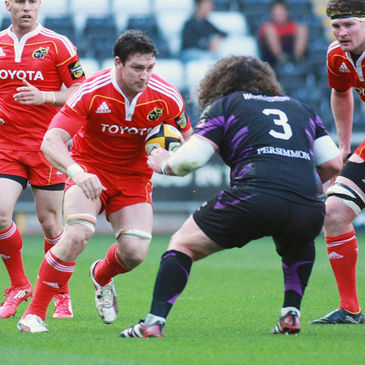 Munster's David Wallace takes on Ospreys prop Adam Jones