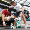 Physiotherapist Cameron Steele is seen assisting flanker David Wallace, who will make his seasonal bow for Ireland against England