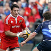 David Wallace, who was winning his 200th Munster cap, weighs up his options as Leinster's Eoin Reddan closes in on him