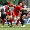 Munster flanker David Wallace tries to get past Harlequins' Maurie Fa'asavalu and Jordan Turner-Hall