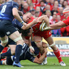 Richardt Strauss and Kevin McLaughlin try to stop David Wallace in his tracks as Munster pile on the pressure